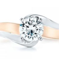 How can you differentiate between lab-grown and natural diamonds