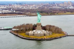 The Statue of Liberty is a colossal neoclassical sculpture on Liberty Island in New York