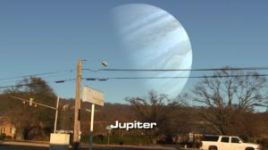 on Jupiter, you might be able to make out the 4 big moons, They all have orbits larger than our moons orbit