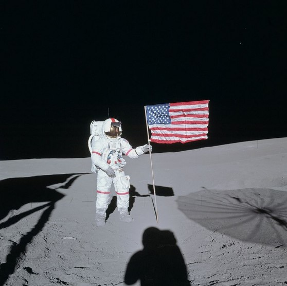 Shepard poses next to the American flag on the Moon during Apollo 14
