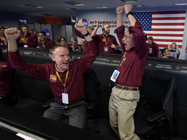 Mars InSight team members Kris Bruvold, left, and Sandy Krasner react after receiving confirmation that the Mars InSight lander successfully touched down on the surface of Mars