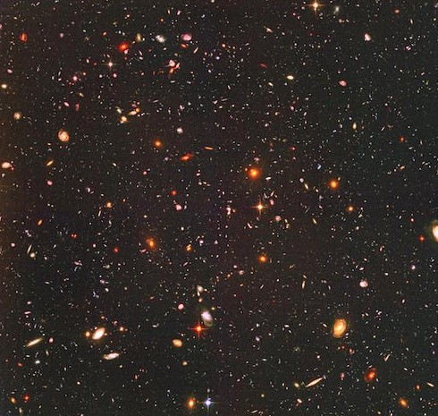 This is the picture taken by the Hubble Space Telescope showing thousands of galaxies. Even the tiny dots are whole galaxies—image credit_NASA