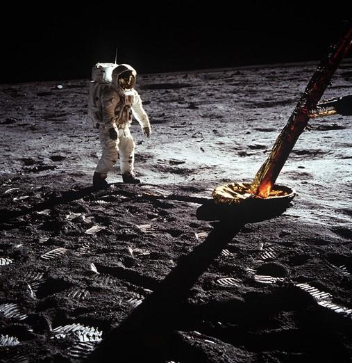 Astronaut Edwin E. Aldrin Jr., lunar module pilot, walks on the surface of the moon near a leg of the Lunar Module during the Apollo 11